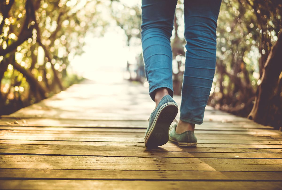 Low Section Of Woman Walking On Boardwalk During Sunny Day (Getty Images/Suwaree Tangbovornpichet/EyeEm)