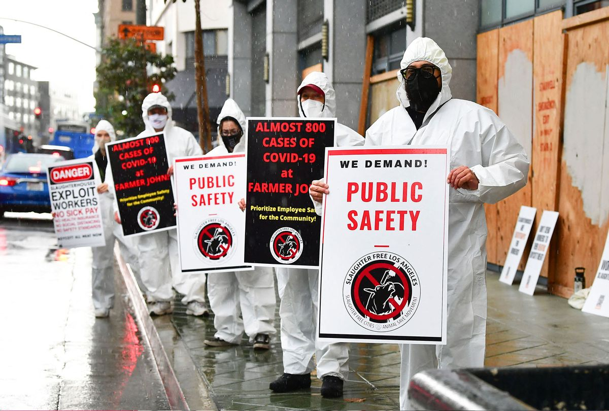 Protesters in front of the Occupational Safety and Health Administration (OSHA) building in Los Angeles, California on March 12, 2021, calling on OSHA to do more to protect workers from Farmer John's slaughterhouse where the total number of Covid-19 positive cases reached 789 as of March 11, totalling almost half the workforce of 1,837 workers. (FREDERIC J. BROWN/AFP via Getty Images)