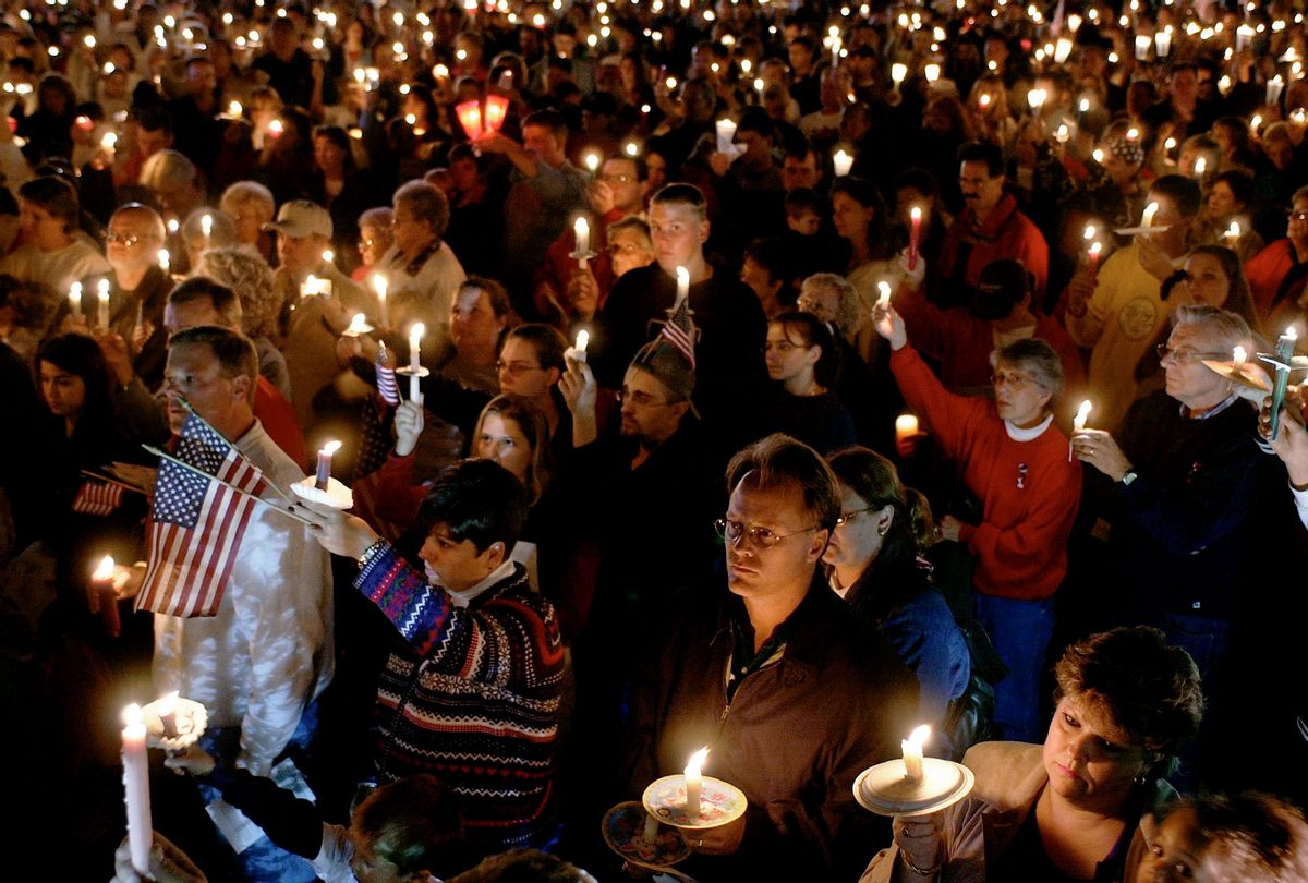 A candlelight vigil drawing over 1,000 people in the days after the devastating 9/11 terrorist attacks on New York City's World Trade Center & the Pentagon. (Steve Liss/Getty Images)