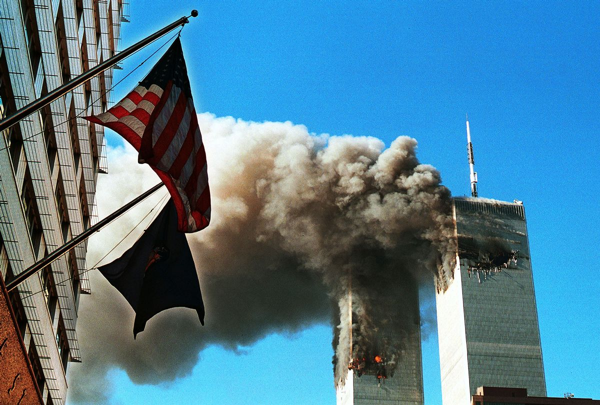 Smoke Pours From The World Trade Center After Being Hit By Two Planes September 11, 2001 In New York City. (Craig Allen/Getty Images)