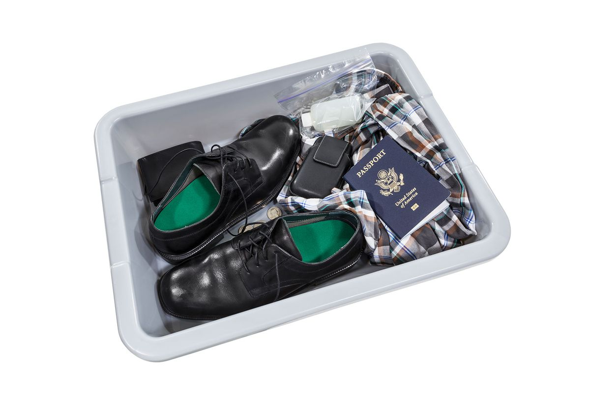 Airport security screening tray (Getty Images/trekandshoot)