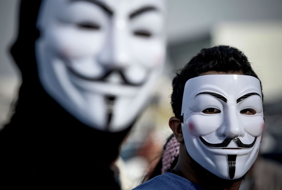 Protesters wearing Guy Fawkes masks used by the Anonymous movement (MOHAMMED AL-SHAIKH/AFP via Getty Images)