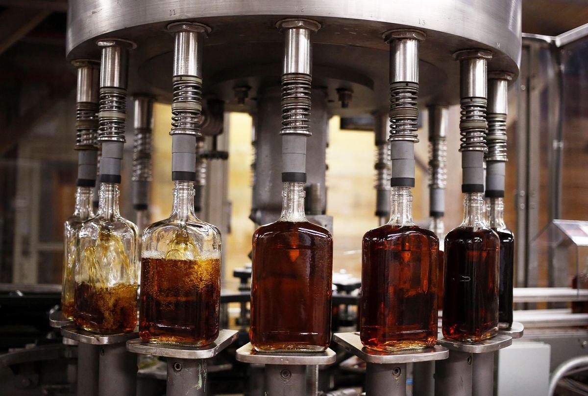 Bottles of single barrel bourbon are filled on the bottling line at a distillery (Getty Images/Luke Sharrett/Bloomberg)
