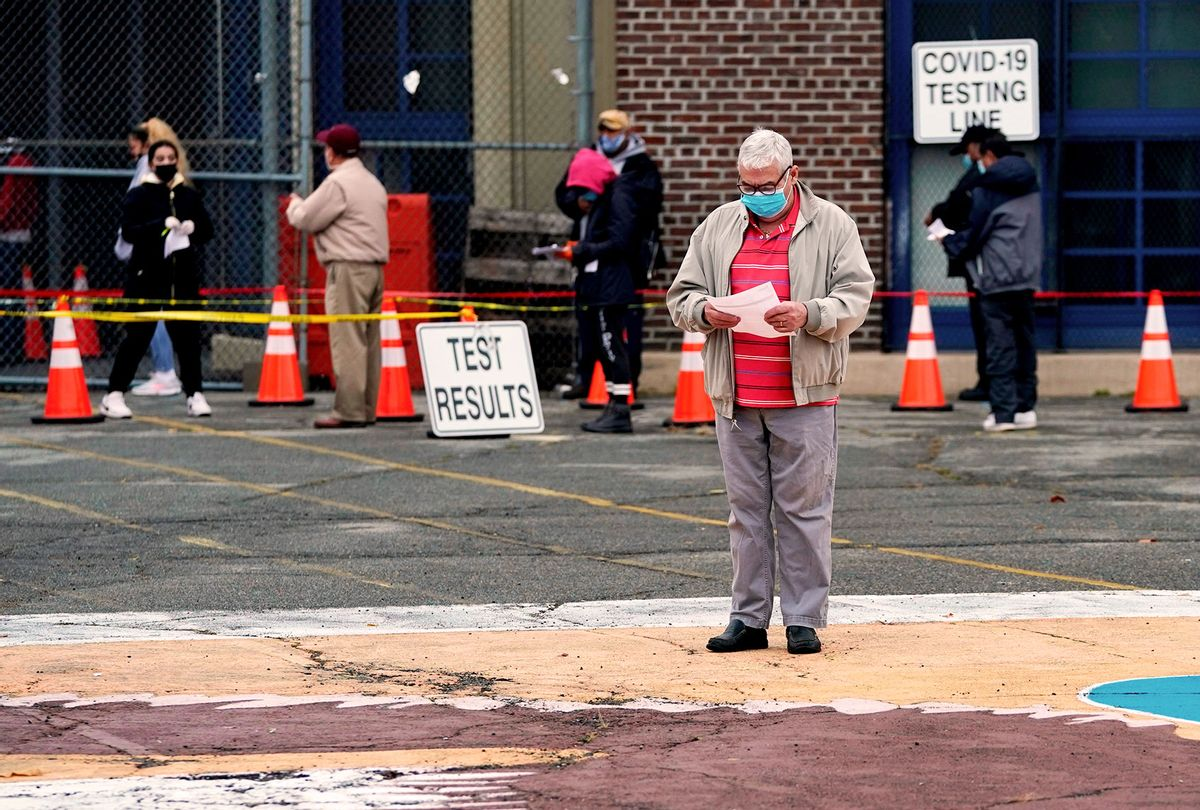 People wait in line to get tested for Covid-19 at the Ann Street School Covid-19 Testing Center in Newark, New Jersey (TIMOTHY A. CLARY/AFP via Getty Images)