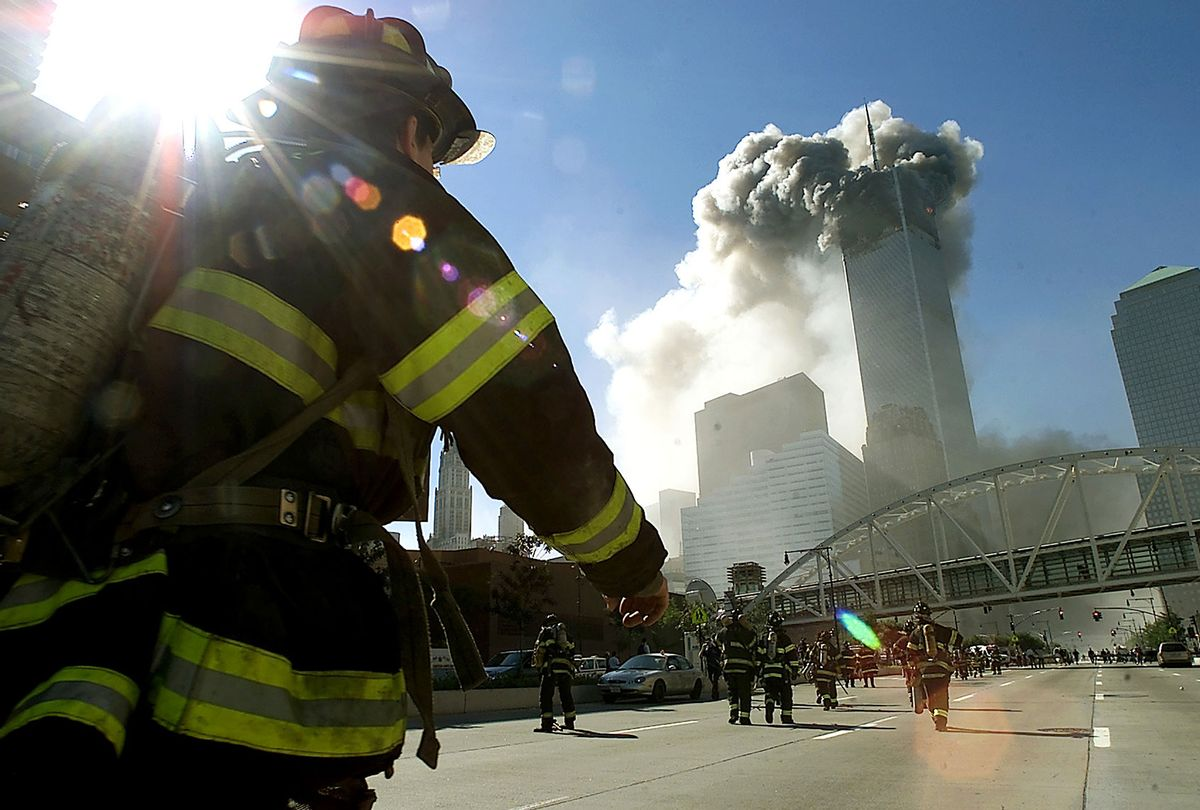 Firefighters walk towards one of the tower at the World Trade Center before it collapsed after a plane hit the building September 11, 2001 in New York City. (Jose Jimenez/Primera Hora/Getty Images)