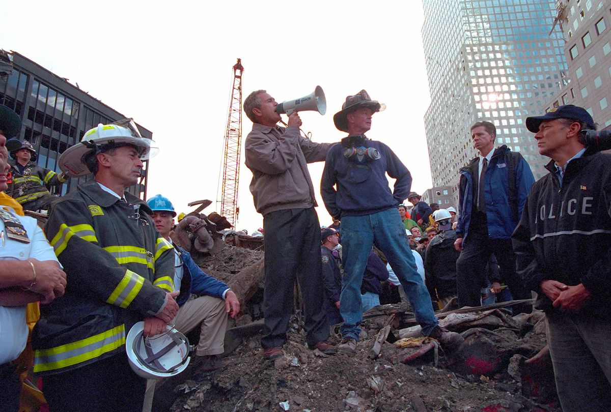 Standing atop rubble with retired New York City firefighter Bob Beckwith, President George W Bush rallies firefighters and rescue workers during an impromptu speech at the site of the collapsed World Trade Center in New York City, New York, September 14, 2001. Image courtesy National Archives. (Smith Collection/Gado/Getty Images)