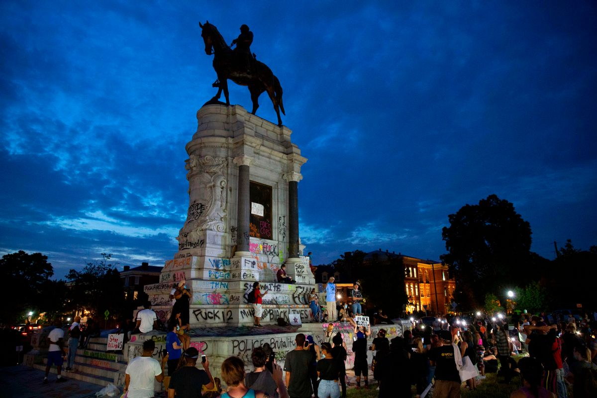 People gather around the Robert E. Lee statue on Monument Avenue in Richmond, Virginia, on June 4, 2020, amid continued protests over the death of George Floyd in police custody. (Ryan M. Kelly/AFP via Getty Images)