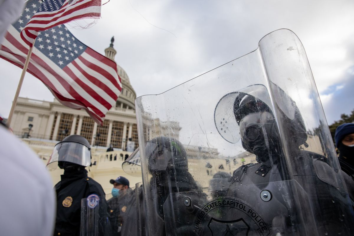Pro-Trump protestors clash with police during the tally of electoral votes that that would certify Joe Biden as the winner of the U.S. presidential election outside the US Capitol in Washington, DC on Wednesday, January 6, 2021.  (Amanda Andrade-Rhoades/For The Washington Post via Getty Images)