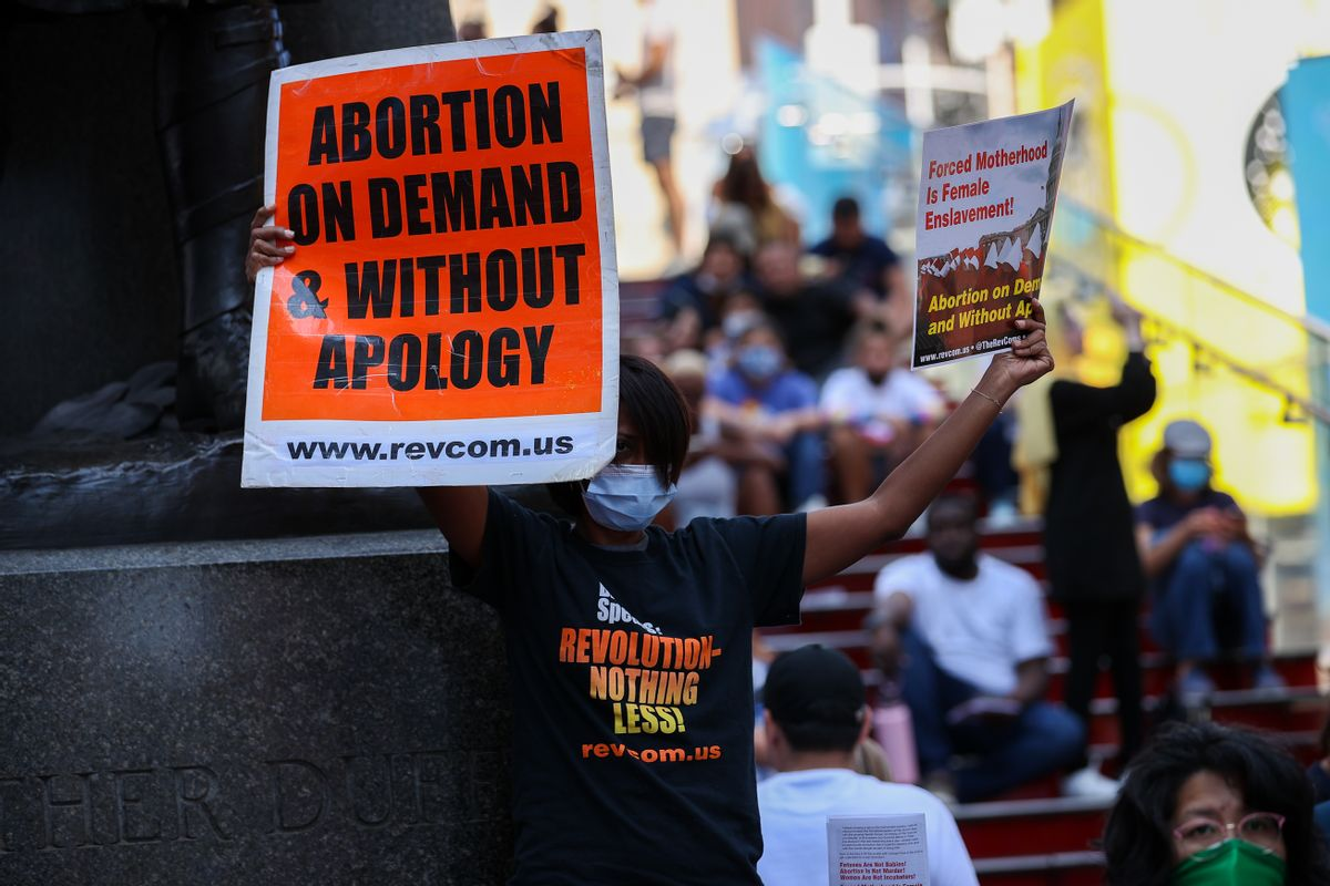 A group of people are gathered at the Times Square of New York City, United States on September 4, 2021 to protest that a Texas law banned abortion. (Tayfun Coskun/Anadolu Agency via Getty Images)