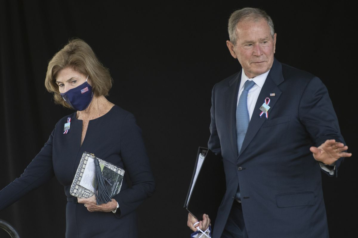 Former President George W. Bush and Barbara Bush walk off stage at the Flight 93 National Memorial commemorating the 20th anniversary of the crash of Flight 93 and the September 11th terrorist attacks, on Sept. 11, 2021. (Noah Riffe/Anadolu Agency via Getty Images)