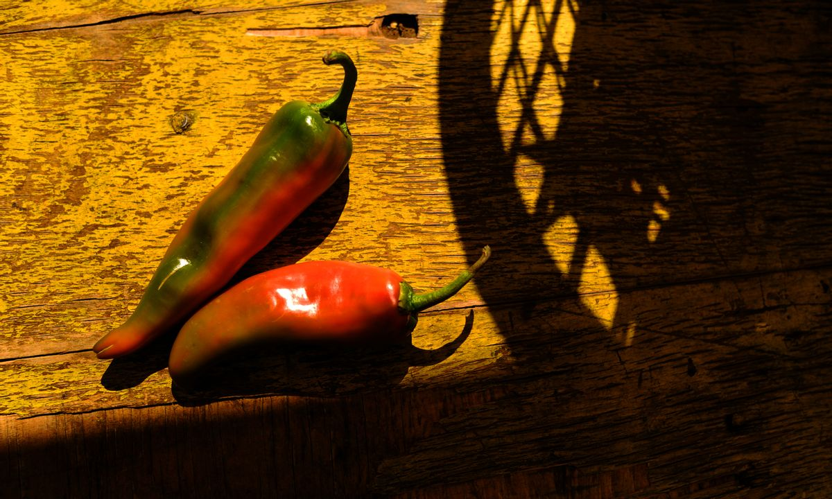 Baskets of hatch green chiles are ready to be roasted at a chile stand. (RJ Sangosti/The Denver Post via Getty Images)