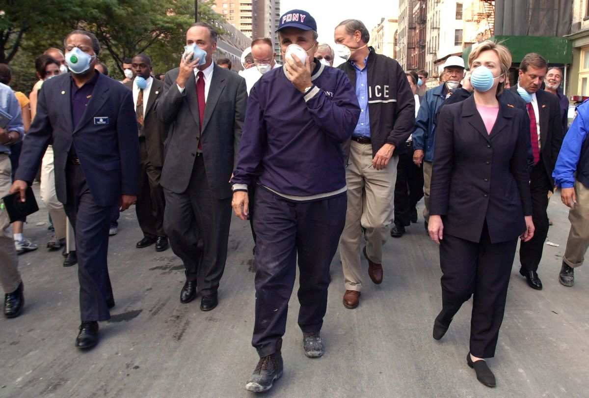 New York City Mayor Rudolph Giuliani (C) leads US Senator Charles Schumer, R-NY (2nd L), New York Governor George Pataki (2nd R) and US Senator Hillary Rodham Clinton, D-NY (R), on a tour of the site of the World Trade Center disaster 12 September 2001 in New York. (ROBERT F. BUKATY/AFP via Getty Images)