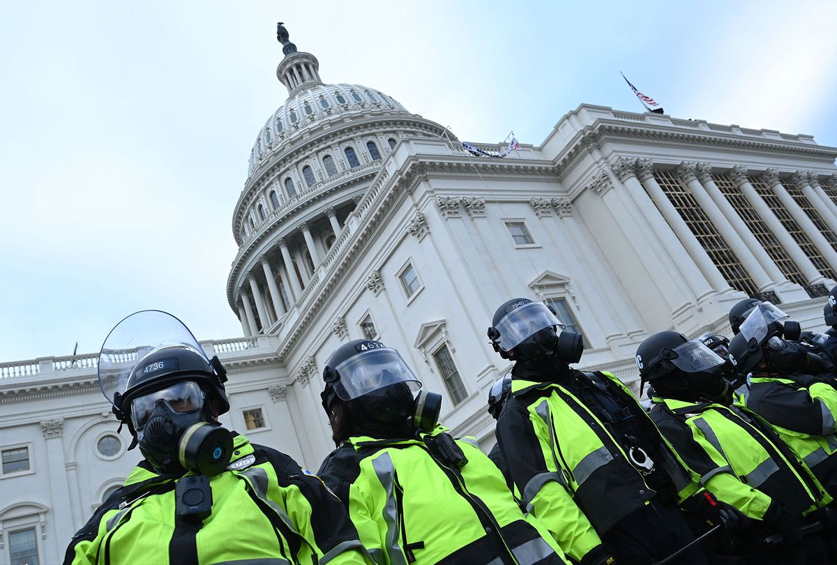 Police stand as supporters of US President Donald Trump protest outside the US Capitol on January 6, 2021, in Washington, DC. (BRENDAN SMIALOWSKI/AFP via Getty Images)
