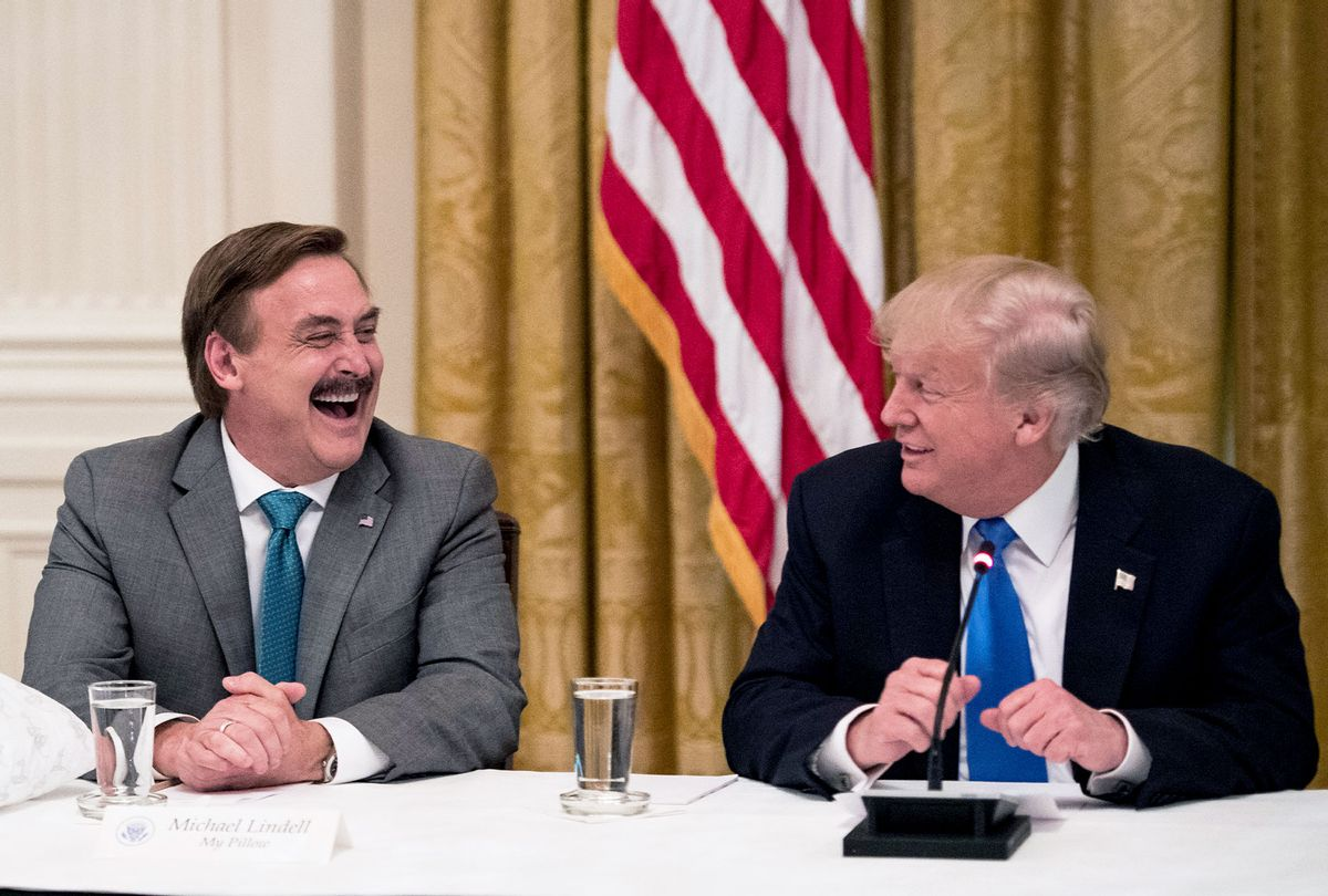 """Michael Lindell, with My Pillow, laughs with President Donald Trump during a """"Made in America,"""" roundtable event in the East Room at the White House in Washington, DC on Wednesday, July 19, 2017. (Jabin Botsford/The Washington Post via Getty Images)"""