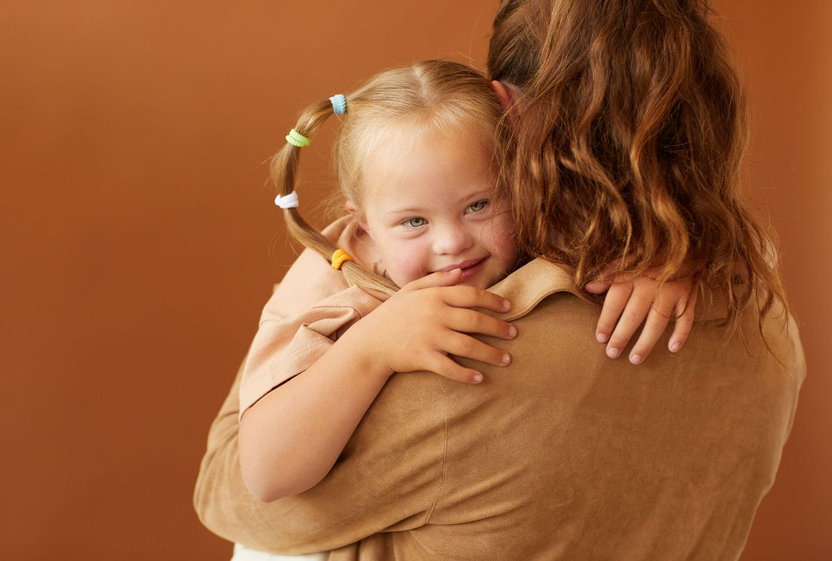 Mother Holding Autistic Daughter (Getty Images/SeventyFour)