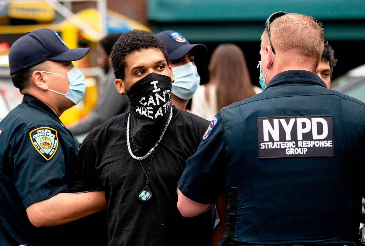 """NYPD officers arrest a protestor during a """"Black Lives Matter"""" demonstration on May 28, 2020 in New York City, in outrage over the death of a black man in Minnesota who died after a white policeman kneeled on his neck for several minutes. (JOHANNES EISELE/AFP via Getty Images)"""