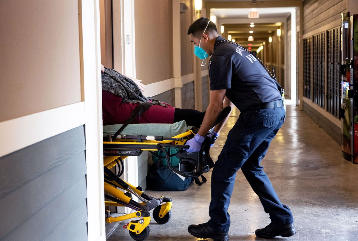 Houston Fire Department paramedics transport a woman with breathing difficulties to a hospital on September 14, 2021 in Houston, Texas. Texas' Harris County continues to see large number of Covid-19 hospitalizations due to the Delta variant surge in the state. (John Moore/Getty Images)