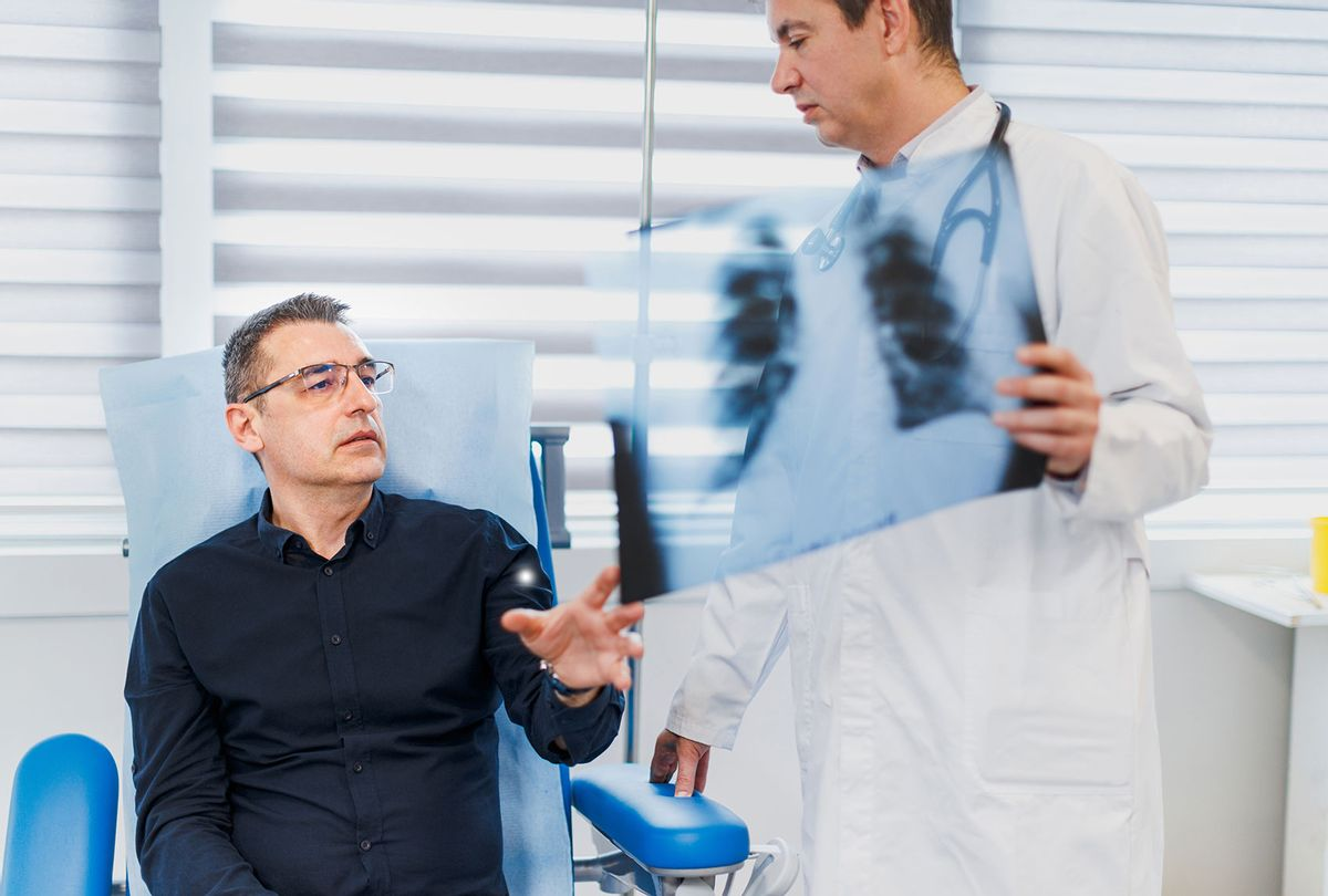 Patient speaking with doctor about scans (Getty Images/zoranm)