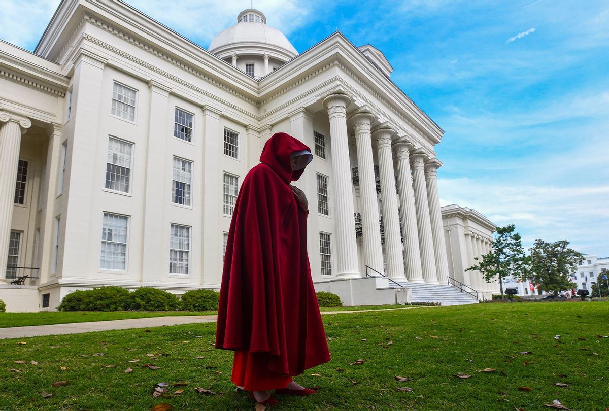 """A protestor dressed as a character from the Hulu TV show """"The Handmaid's Tale,"""" based on the best-selling novel by Margaret Atwood, walks back to her car after participating in a rally against one of the nation's most restrictive bans on abortions on May 19, 2019 in Montgomery, Alabama. (Julie Bennett/Getty Images)"""
