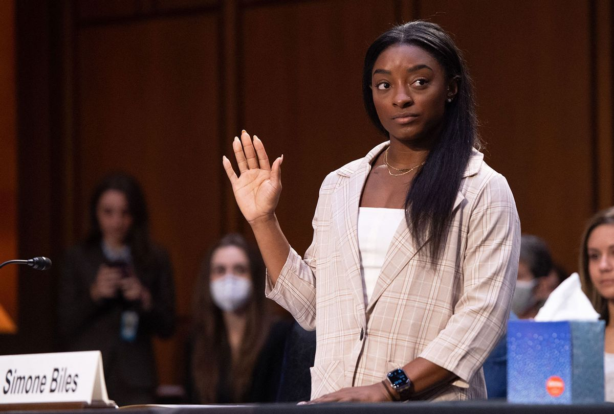 Simone Biles is sworn in to testify during a Senate Judiciary hearing about the FBI handling of the Larry Nassar investigation of sexual assault (SAUL LOEB/POOL/AFP via Getty Images)