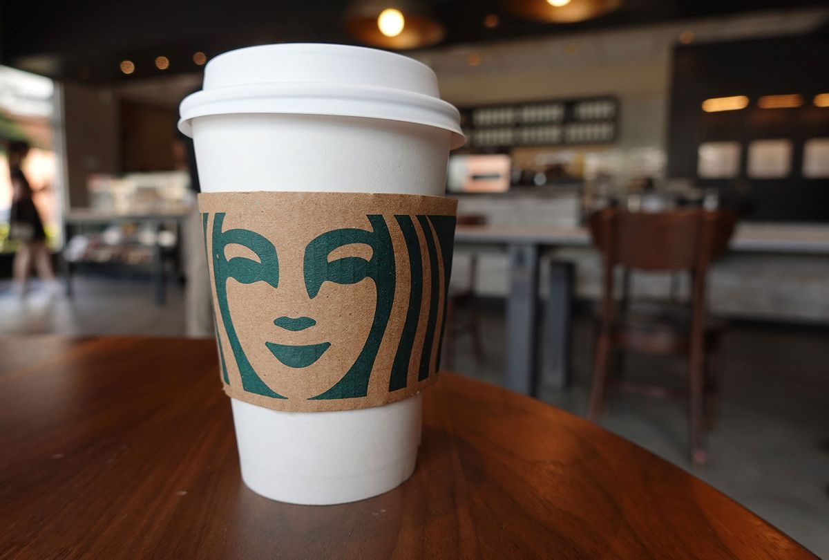 A Starbucks coffee cup sits on a table (Joe Raedle/Getty Images)