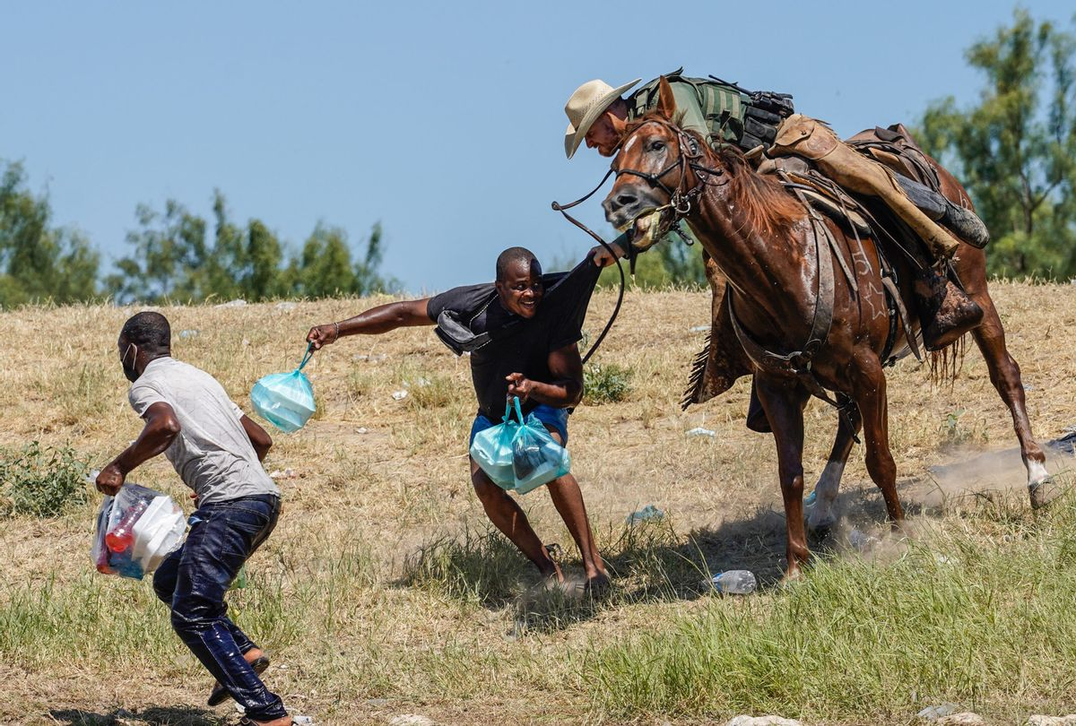 A United States Border Patrol agent on horseback tries to stop a Haitian migrant from entering an encampment on the banks of the Rio Grande near the Acuña Del Rio International Bridge in Del Rio, Texas on September 19, 2021 (Paul Ratje/AFP via Getty Images)