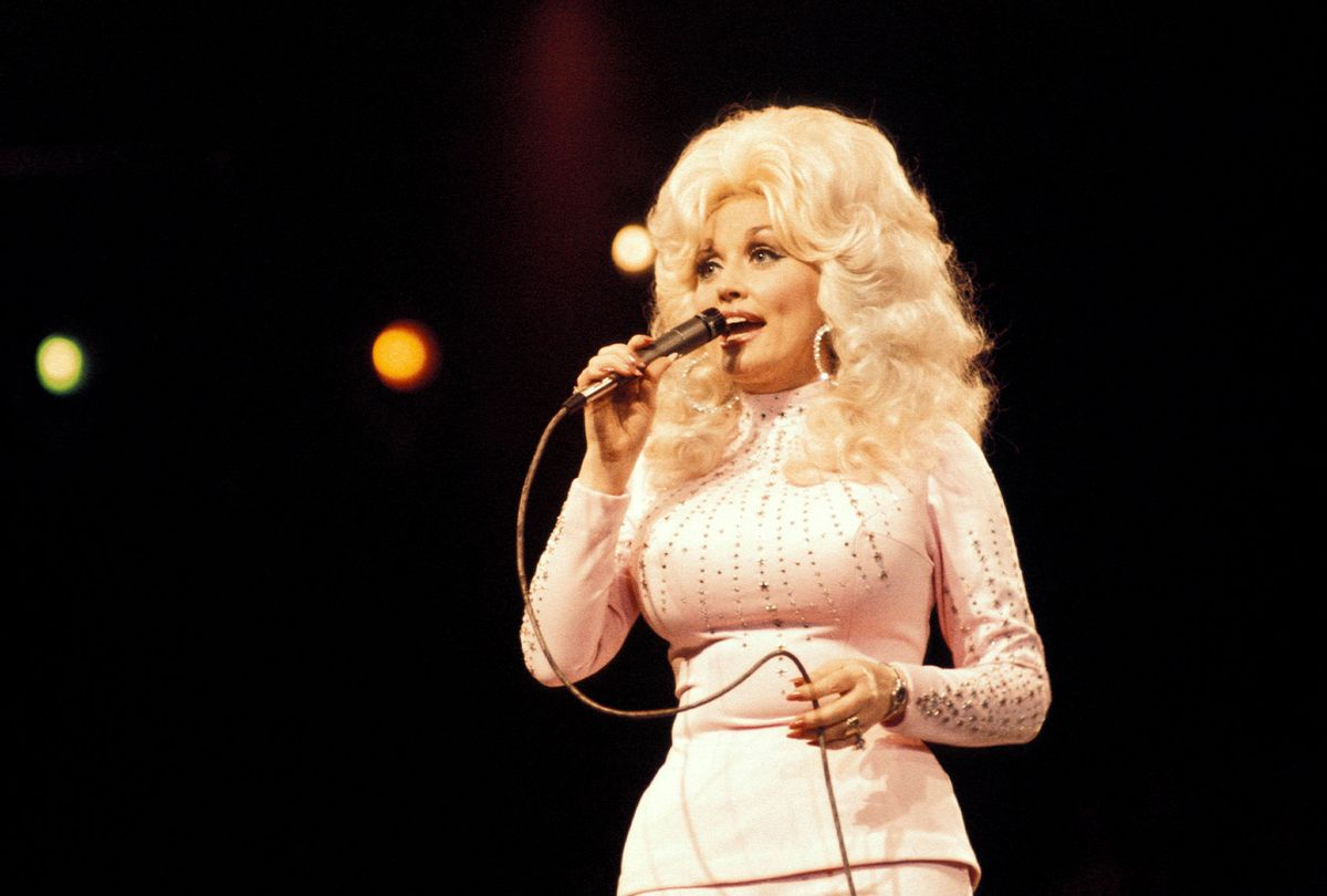 Dolly Parton performing live onstage at the UK Country Music Festival (Andrew Putler/Redferns/Getty Images)