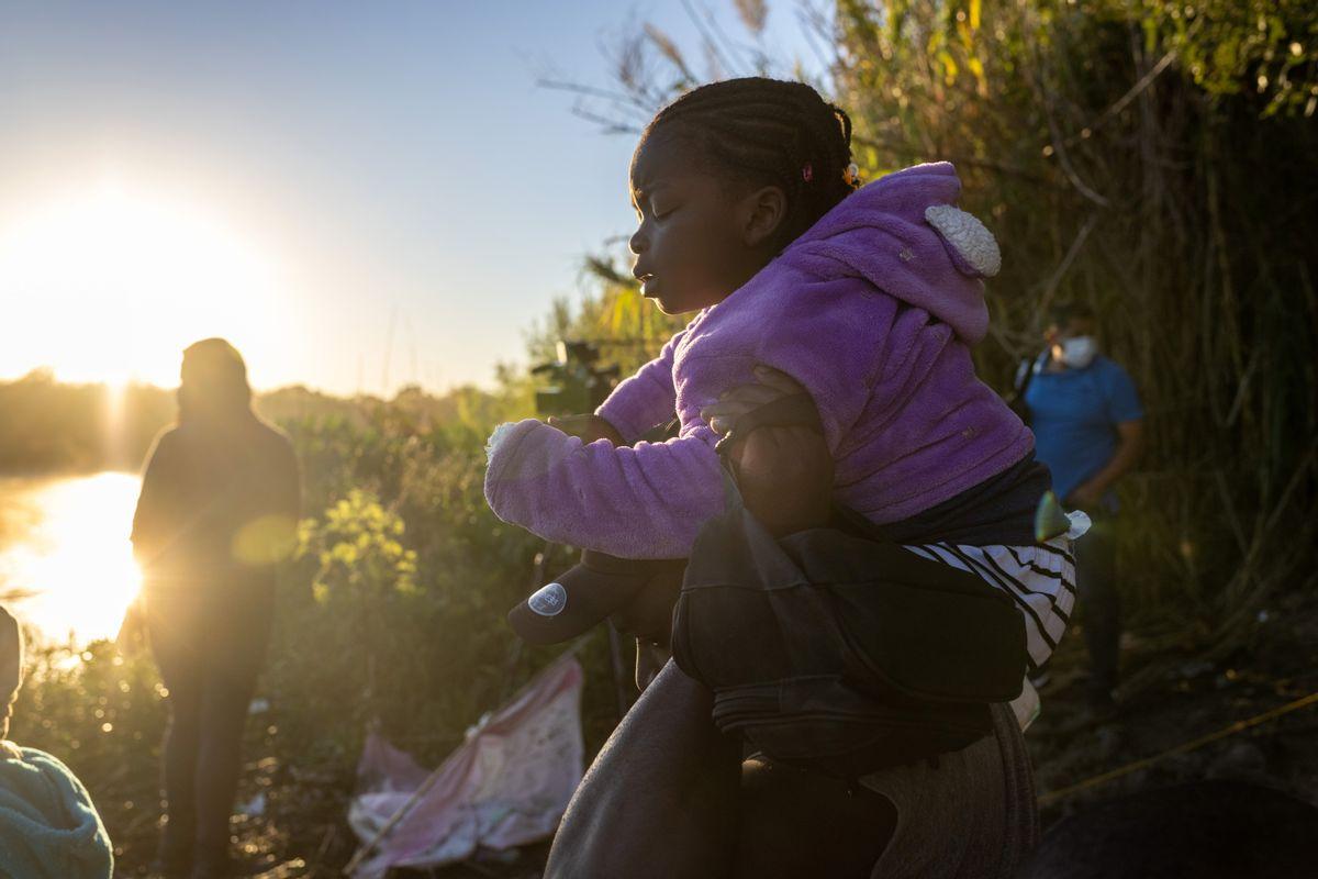 Haitian immigrants prepare to cross the Rio Grande into Del Rio, Texas, on Sept. 23, 2021, from Ciudad Acuna, Mexico.  (John Moore/Getty Images)