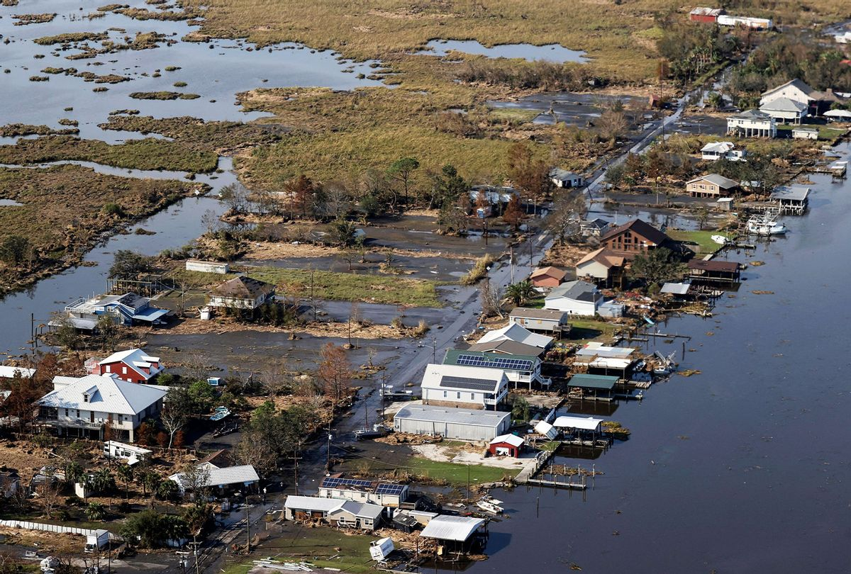 A view of flood damaged buildings are seen as US President Joe Biden (not pictured) inspects the damage from Hurricane Ida onboard Marine One during an aerial tour of communities in Laffite, Grand Isle, Port Fourchon and Lafourche Parish, Louisiana, September 3, 2021. (JONATHAN ERNST/POOL/AFP via Getty Images)