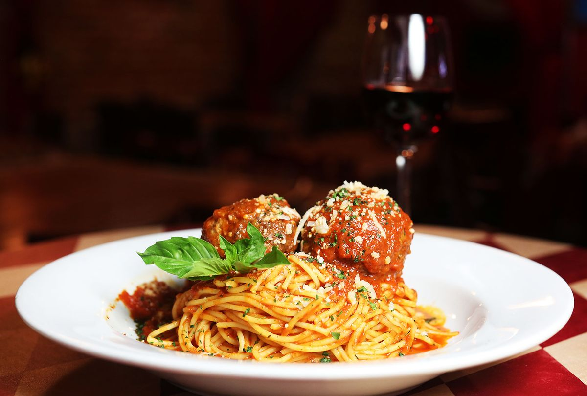 Spaghetti and meatballs served with red wine at a restaurant (Getty Images/Marianna Massey)