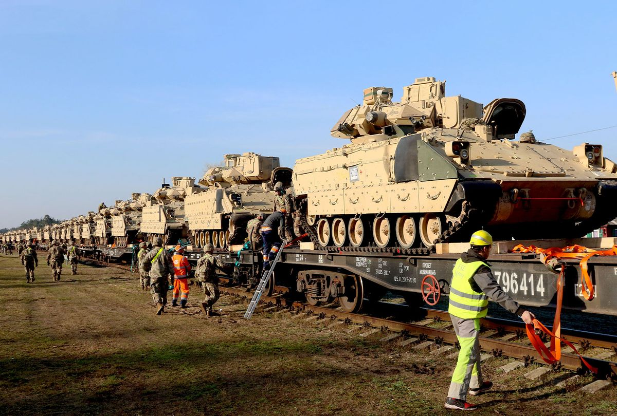 Members of the US Army 1st Division 9th Regiment 1st Battalion unload heavy combat equipment including Abrams tanks and Bradley fighting vehicles at the railway station near the Pabrade military base in Lithuania, on October 21, 2019. (PETRAS MALUKAS/AFP via Getty Images)