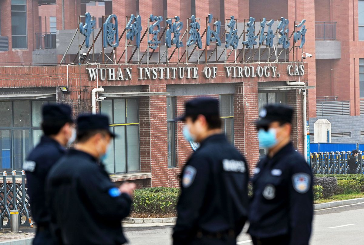 Security personnel stand guard outside the Wuhan Institute of Virology in Wuhan as members of the World Health Organization (WHO) team investigating the origins of the COVID-19 coronavirus make a visit to the institute in Wuhan in China's central Hubei province on February 3, 2021. (HECTOR RETAMAL/AFP via Getty Images)