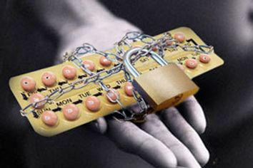 Credit Card Wrapped in Chains and Padlocked --- Image by © Royalty-Free/Corbis