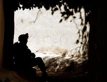 A U.S. Marine takes a break during a patrol in a village in Golestan district of Farah province