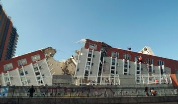 Rescue workers search for victims and survivors after an apartment complex collapsed during an earthquake in Concepcion