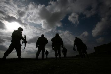 U.S. soldiers from Charlie and Echo Company, 4th Brigade combat team,1-508 parachute infantry Regiment walk back to FOB Shamulzai in Zabul province