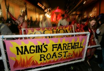 Revelers carry a banner referring to outgoing New Orleans mayor Nagin during the Krewe du Vieux Mardi Gras parade in New Orleans