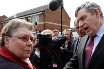 Britain's Prime Minister Gordon Brown speaks with resident Gillian Duffy during a campaign stop in Rochdale