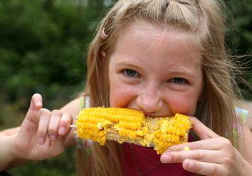 Young Girl Eating Corn