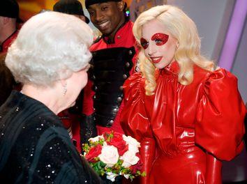 Britain's Queen Elizabeth II meets U.S. singer Lady Gaga following the Royal Variety Performance in Blackpool, England