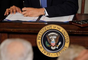 U.S. President Obama signs the healthcare legislation at the White House in Washington