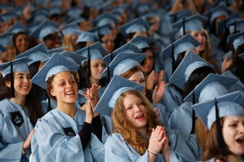 Graduating seniors cheer at the commencement for Barnard College, in New York