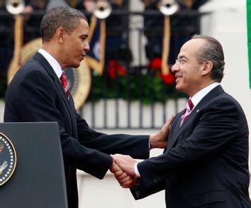 U.S. President Barack Obama shakes hands with Mexico's President Calderon at the White House in Washington