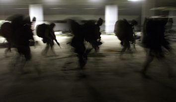 United States Marines from Bravo Co. of the 15th MEU (Marine Expeditionary Unity) march into a barra..