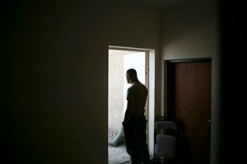 A U.S. soldier stands at the door of a police station, part of the GSS (General Security System), in the southeast of Baghdad