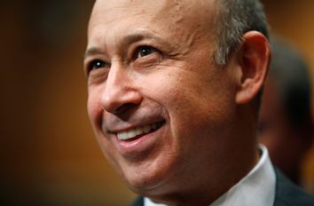 Goldman Sachs CEO Blankfein smiles during testimony before the Senate Homeland Security and Governmental Affairs Investigations Subcommittee hearing on
