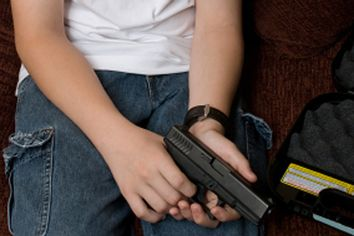 A young boy getting his father's gun without permission.