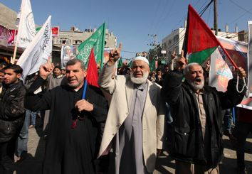 Hamas supporters attend a protest in Jabalya refugee camp in the northern Gaza Strip