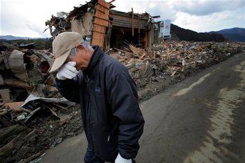 CORRECTION APTOPIX Japan Earthquake