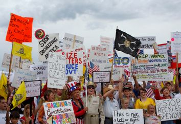 People hold signs during a